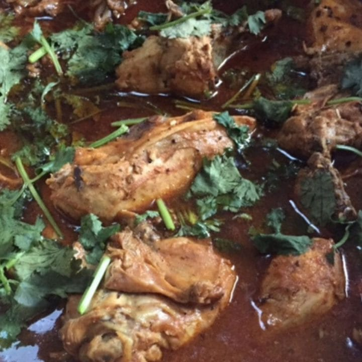 closeup of chicken curry in pot