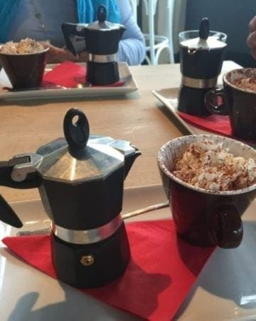 small coffee percolator with cup of affogato on a tray