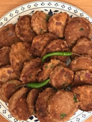 Platter of shami kebabs with 2 green chillies