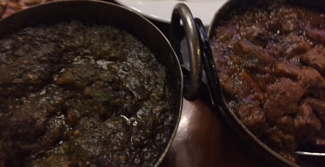 spinach curry next to a lamb curry