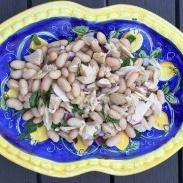 ariel view of tuna bean salad on Italian blue and yellow plate
