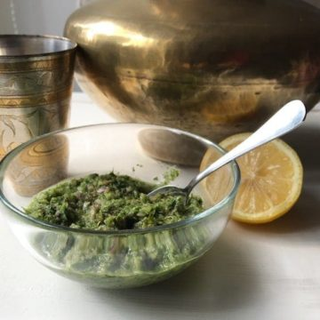 coriander chutney with lemon and brass dishes