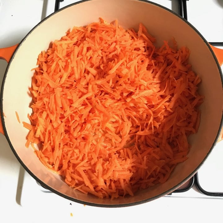 arial view of grated carrots in saucepan on hob