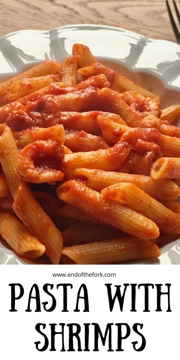 Pin image of pasta with shrimps in tomato sauce in white bowl.