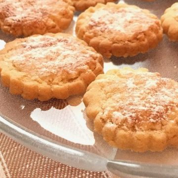 Round shortbread cookies on a glass dish