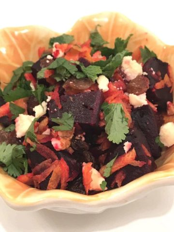 beet salad in a yellow bowl