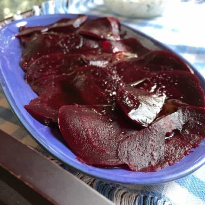 blue dish with sliced boiled beets