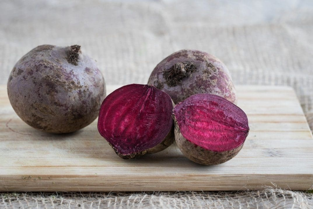 beets, halved and whole, on a chopping board
