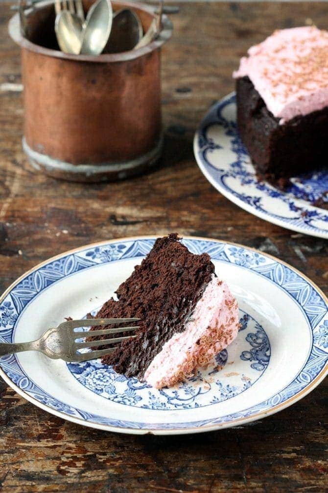 slice of cake with icing on small plate