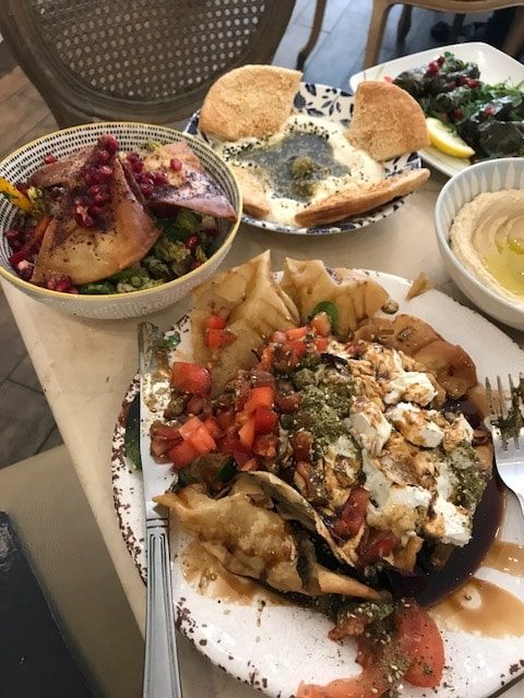 Two salads and labneh on table
