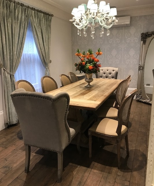 Private dining room with 10 chairs around a long table