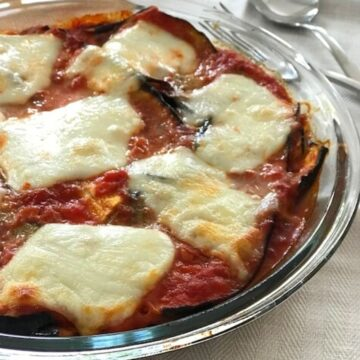 Image of eggplant parmesan in round glass dish.