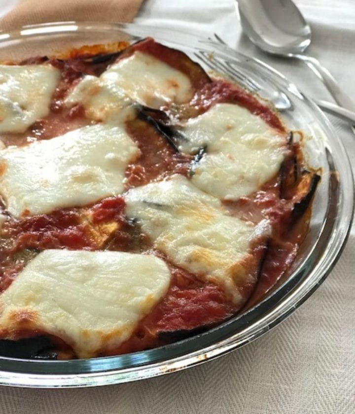 eggplant parmesan in a round glass dish
