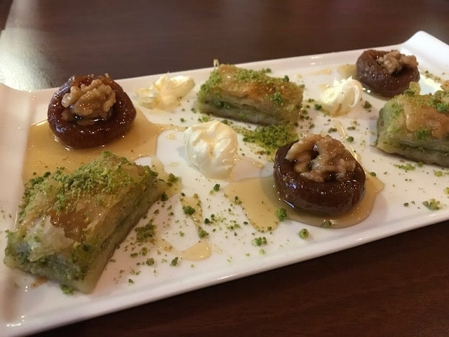 baklava and figs on platter with Turkish clotted cream