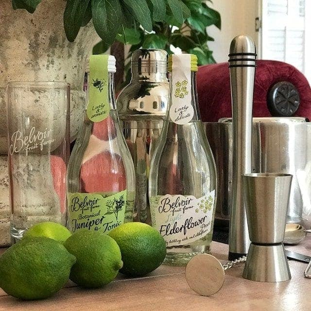 small bottles of Light elderflower presse and jiniper & tonic, with limes