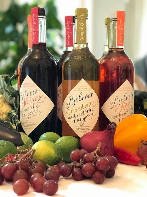 3 varieties of Wines without the hangover surrounded by fresh fruit