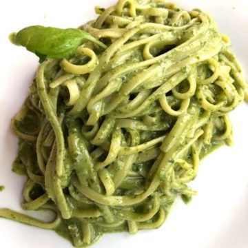 pasta covered in pesto