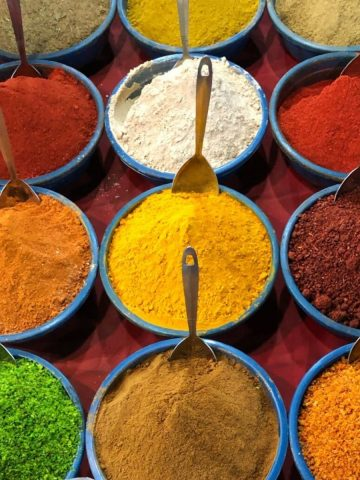 Bowls of colourful Indian spices at a market