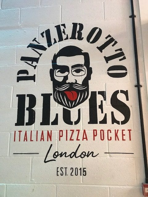 Panzerotto Blues logo on a wall