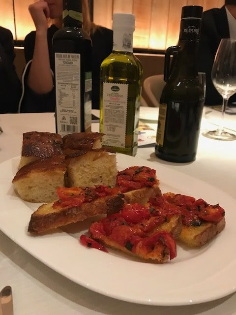 squares of focaccia and bruschetta with tomatoes