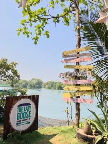 signs for the restaurant by the river