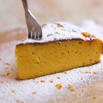 Image of fork in a slice of orange cake showing texture.