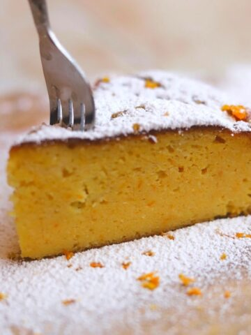 fork in a slice of orange cake