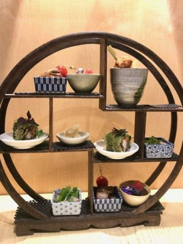 circular stand with small dishes