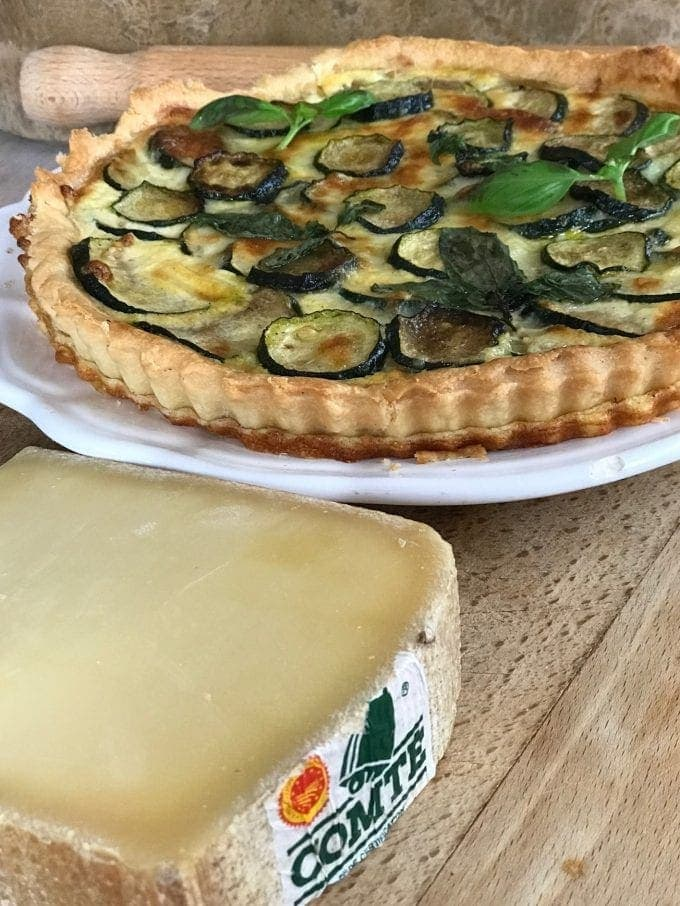 wedge of Comté and zucchini tart