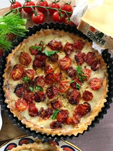 tomato tart next to a piece Comté cheese
