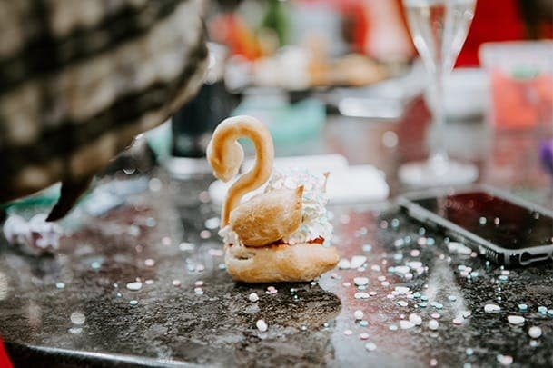 Choux pastry swan on marble counter