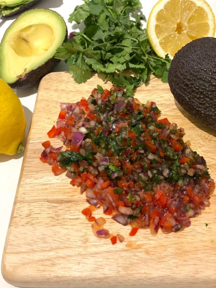 Chopping board with chopped ingredients