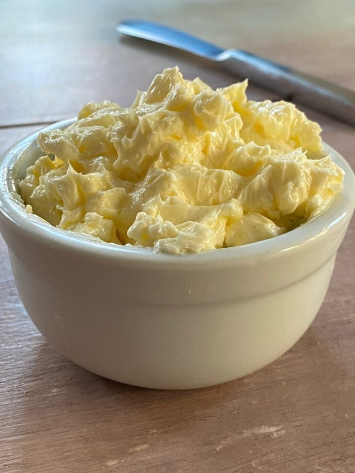 Whipped butter in small white bowl
