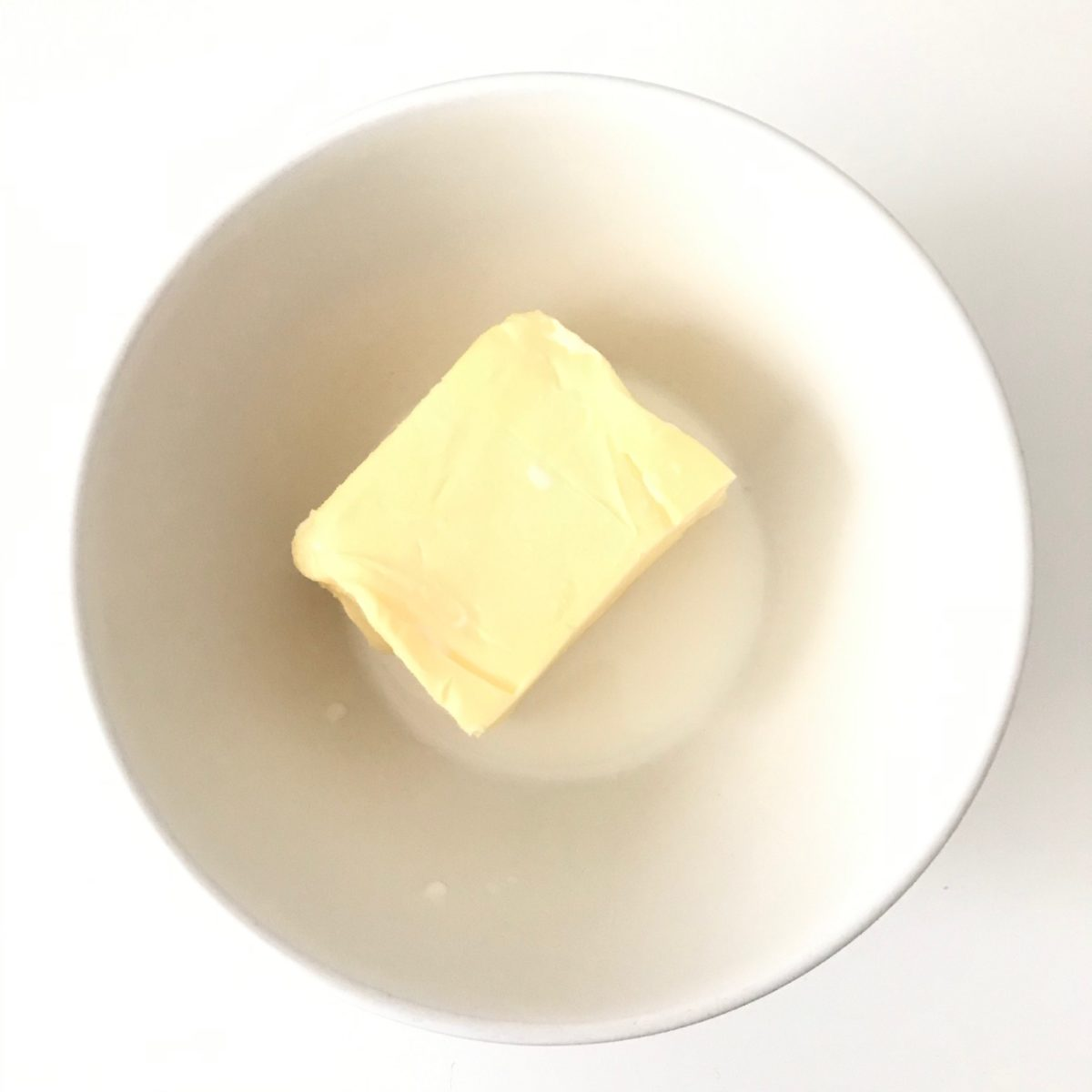 butter and milk in white bowl