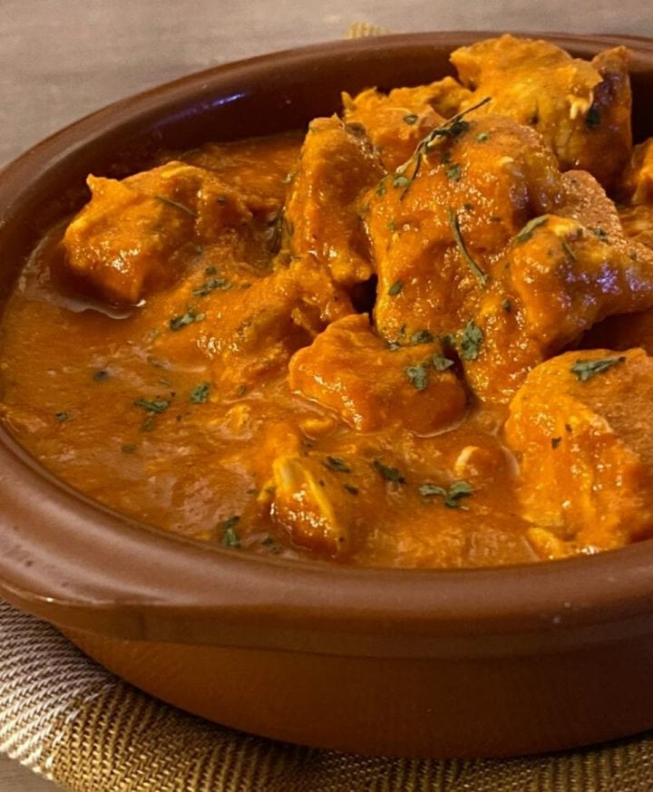 butter chicken in a brown bowl