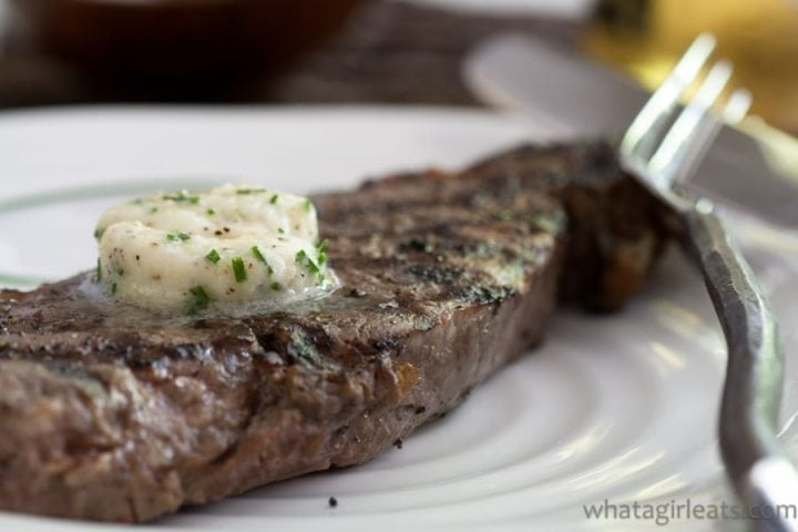 close up of steak with melting round of butter