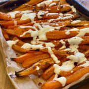 Roasted carrots with dressing on oven tray