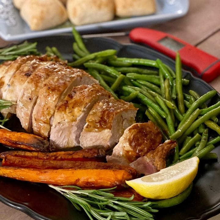 Sliced turkey with roasted carrots and green beans