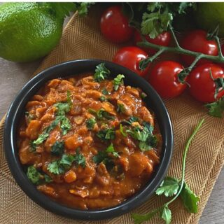 Pinto beans in small black bowl on table