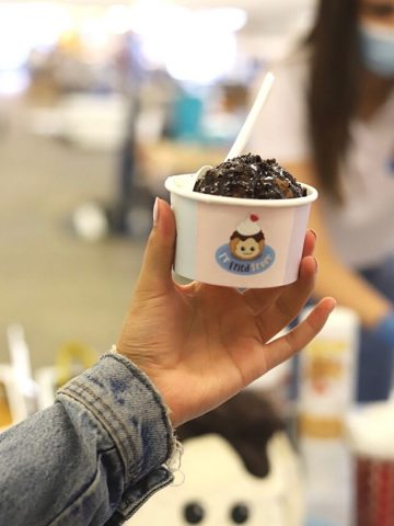 Hand holding cup with fried scoop