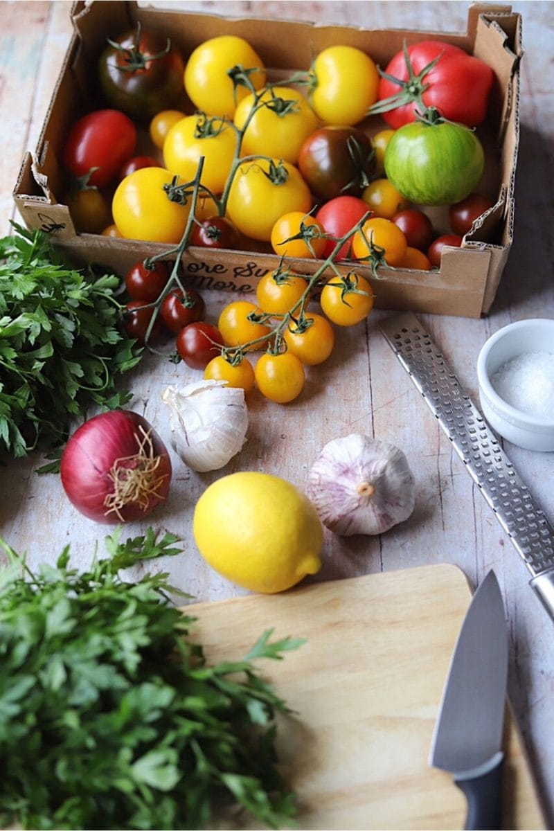 Ingredients for tomato salad on wooden table