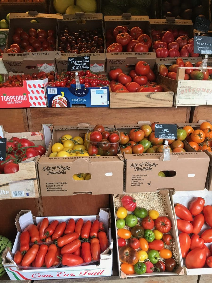 Boxes of tomatoes for sale outside a shop