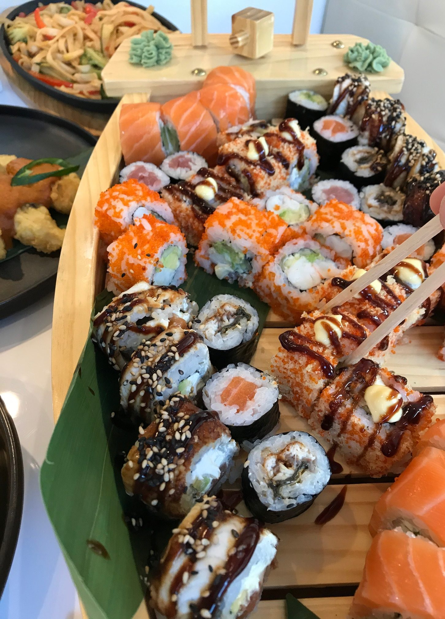 close up of assorted sushi and rolls