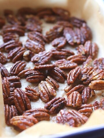 roasted pecans in a roasting dish