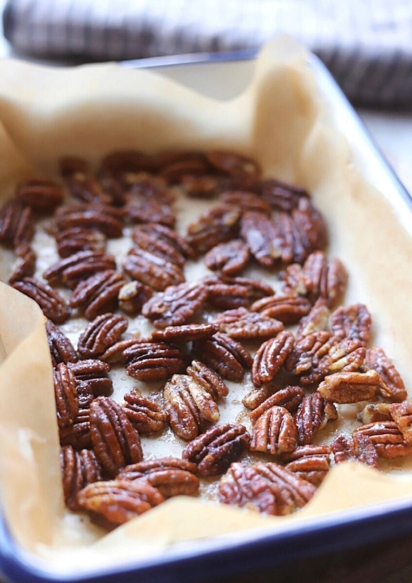 roasted pecans in roasting dish