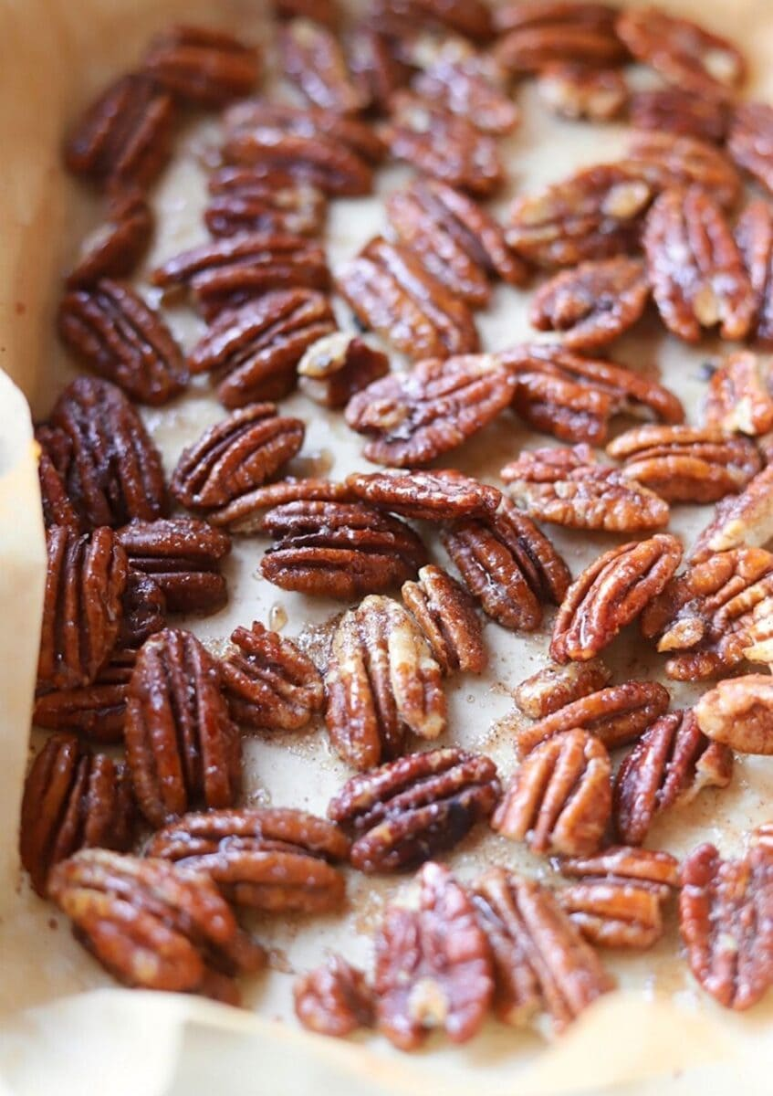 honey roasted pecans on parchment paper