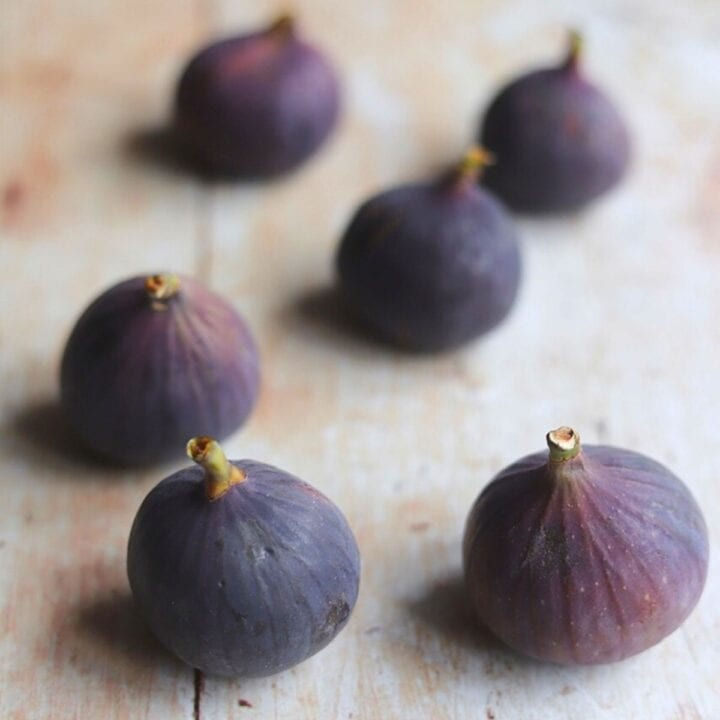 Black Mission figs on wooden table