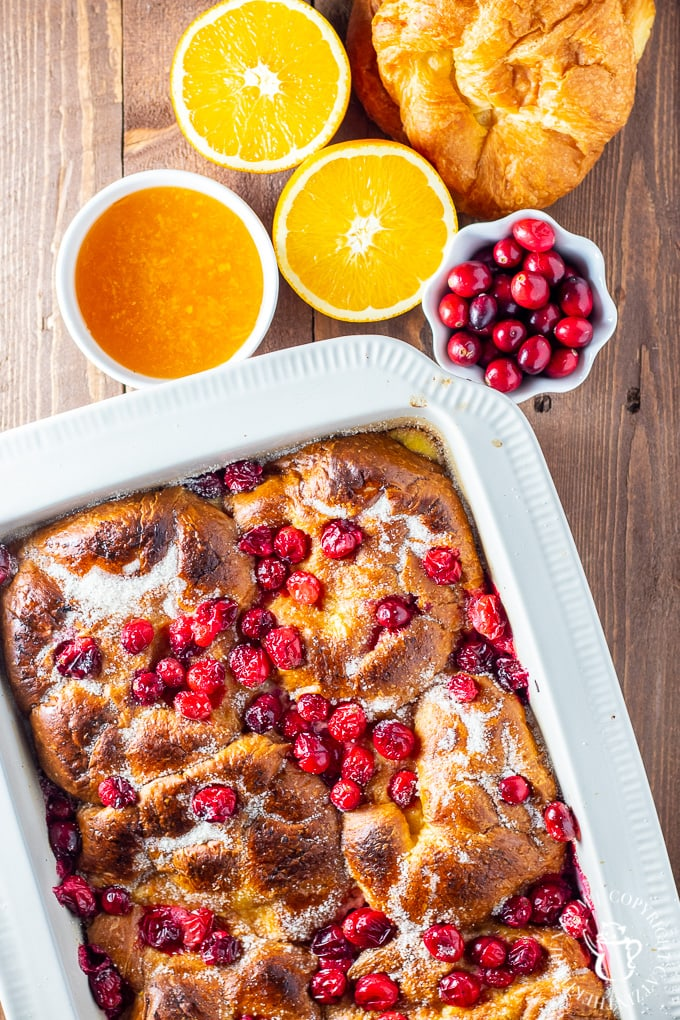 view of croissant french toast in white baking dish