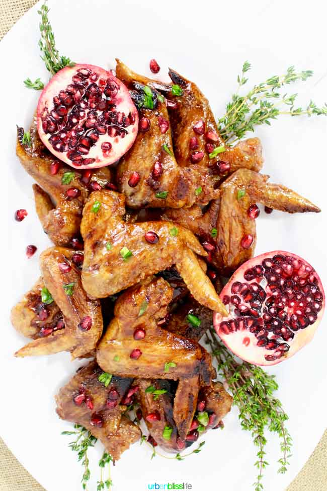 cooked chicken wings with pomegranate seeds
