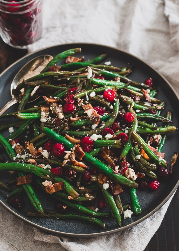 green beans with cranberries on large black serving dish